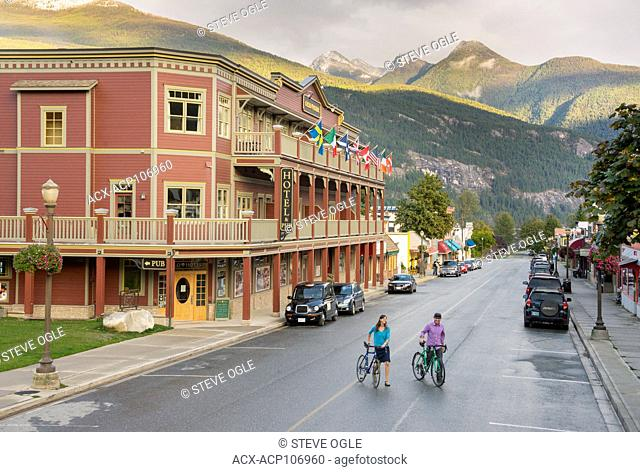 A young couple walking the streets of historic Kaslo, British Columbia