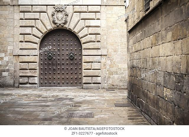 Ancient door in cathedral area, gothic quarter, Barcelona
