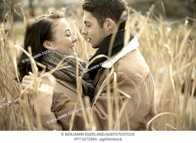 young romantic teenage couple in reed, outdoors in nature, in Cottbus, Brandenburg, Germany