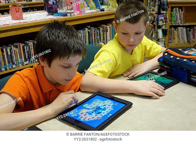 Preteen Boys Using iPad to Learn Coding for School Assignment, Wellsville, New York, USA