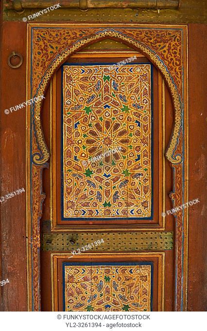 Berber Arabesque painted wood door . The Petite Court, Bahia Palace, Marrakesh, Morroco