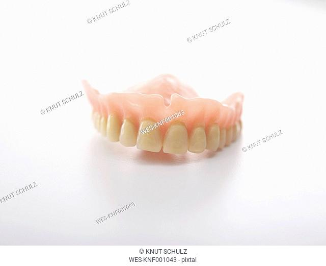 Dentures on white background, close up