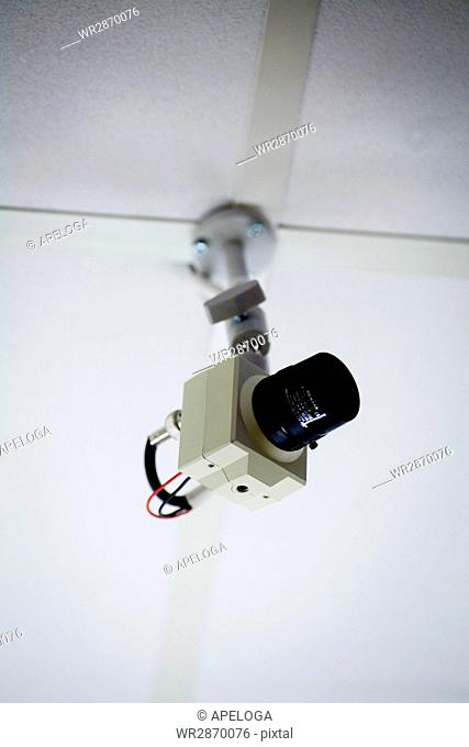 Low angle view of security camera on ceiling