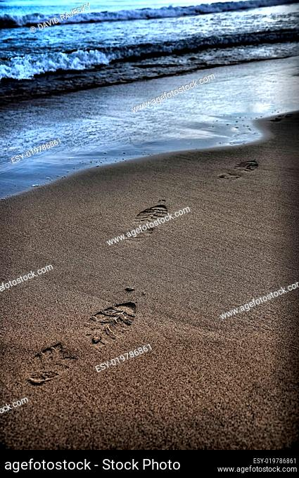 abstract footprint in sand on beach