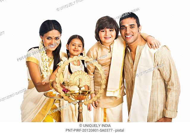 South Indian family smiling at Onam