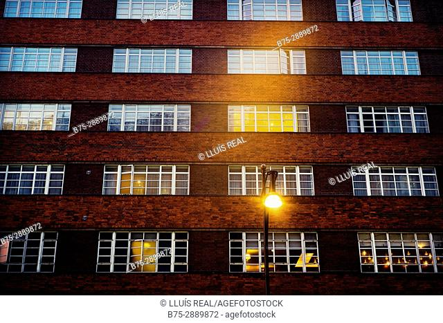 Office building facade with windows and street light. London, England