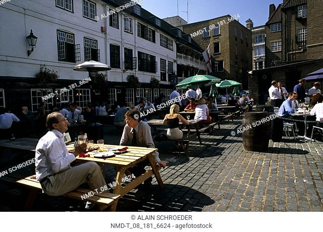 Group of people sitting at a sidewalk cafe, The George Inn, Southwark, London, England