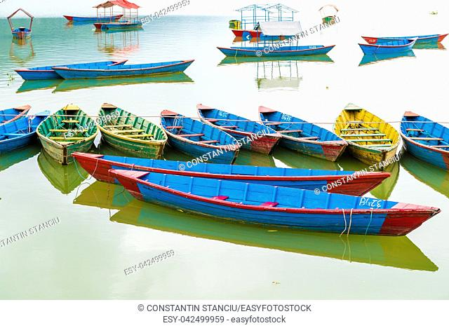Pokhara, Nepal - July 31, 2018 : Colourful boats on Phewa lake in Pokhara, the most popular and visited lake of Nepal