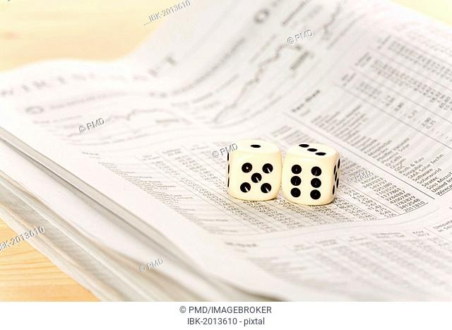 Two dice on a newspaper with stock prices