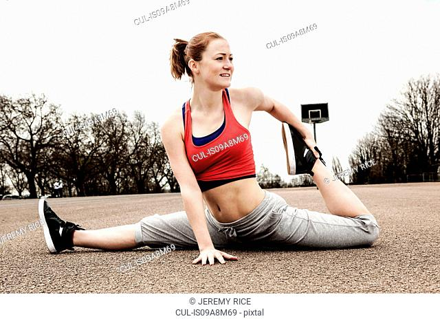 Woman doing splits with left leg bent backwards