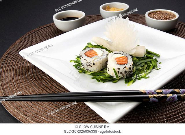 High angle view of sushi served with condiments