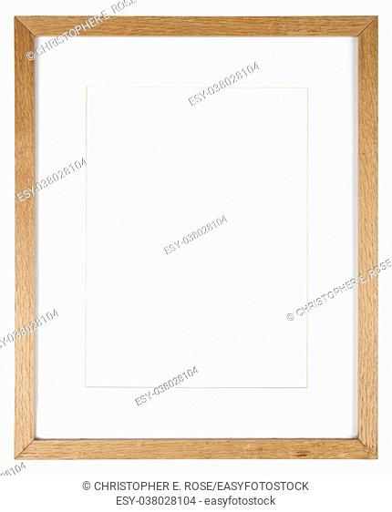 Empty picture frame isolated on white in a simple oak wood grain moulding with a mount