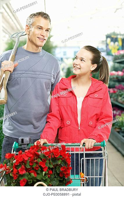 Man and girl shopping for plants