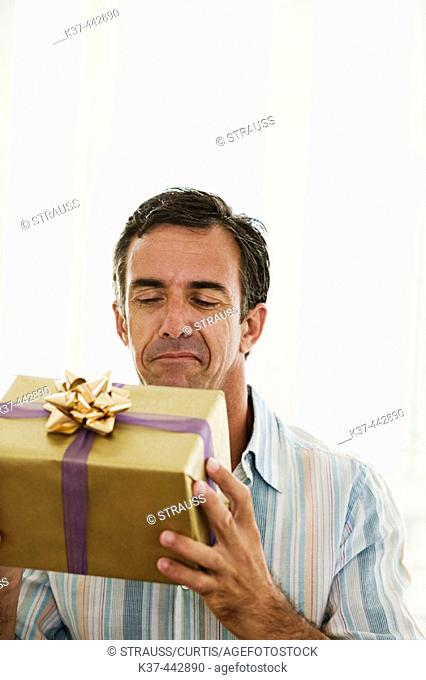 40-45 year old Caucasian man with gift box