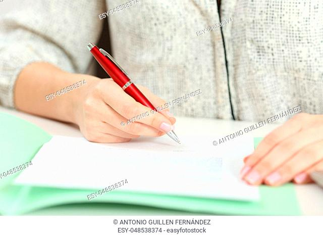 Close up front view portrait of a hand signing a contract on a desktop