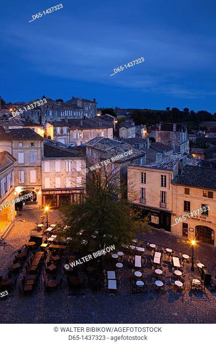 France, Aquitaine Region, Gironde Department, St-Emilion, wine town, elevated view of Place de l'Eglise Monolithe, dusk