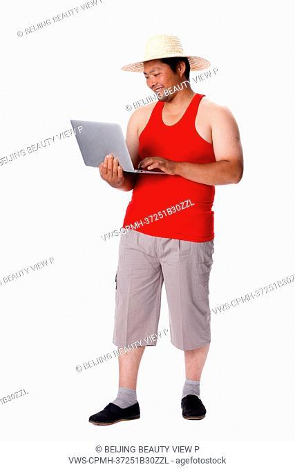 Farmer holding laptop