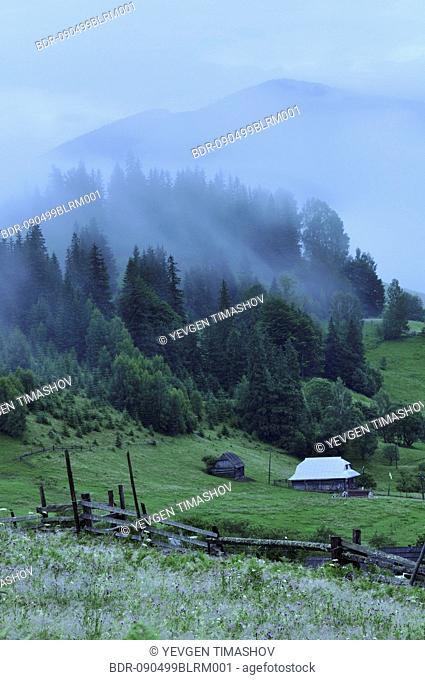fog laying over dzembronya landscape in ukraine