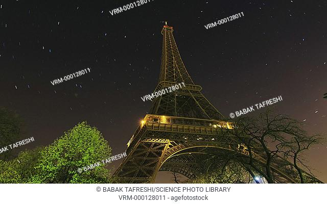 Star trails over Eiffel Tower, timelapse. Stars of the Ursa Major (Great Bear) and Ursa Minor (Little Bear) constellations appear over Eiffel Tower in Paris