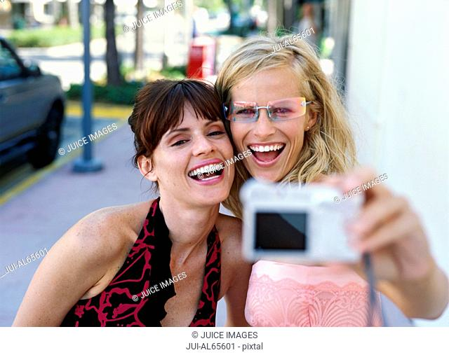 Girlfriends taking a picture of themselves