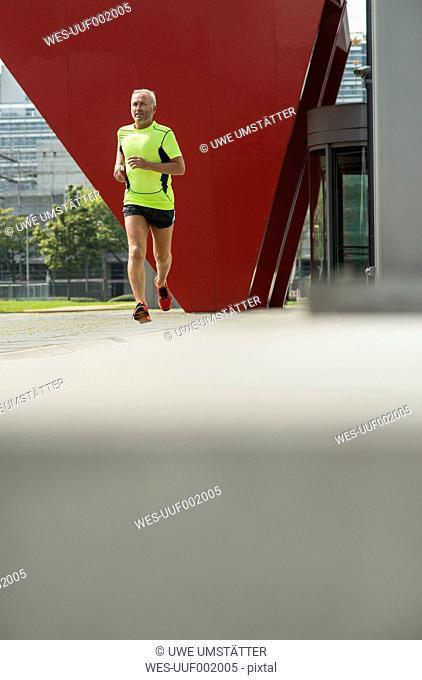 Mature man jogging before his work