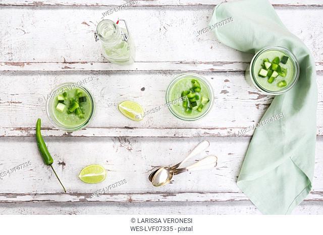 Three glasses of homemade green Gazpacho