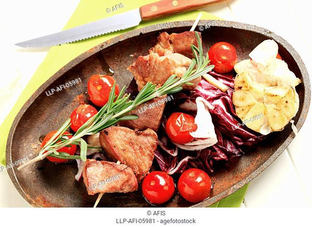 Skewered pork and pan roasted vegetables