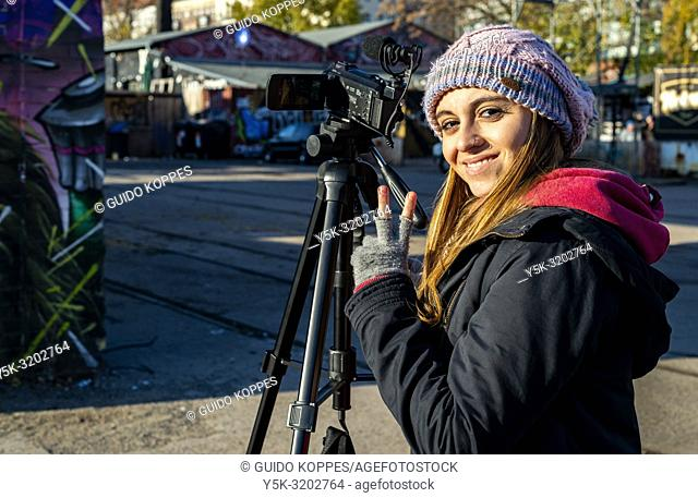 Berlin, Germany. Young, Brazilian girl filming RAW-Gelande, a creative and urban hotspot onside former Eastern Berlin for her Youtube Chanel