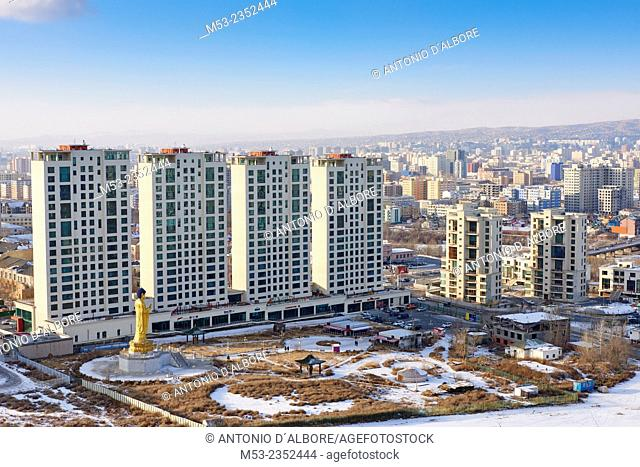 An newly built high rise residential project in Khan-Uul District. In foreground the Golden Statue of Buddha, a popular sighting site for local buddhists