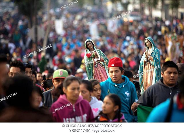 Pilgrims hold an image of the Virgin of Guadalupe at the pilgrimage to Our Lady of Guadalupe Basilica in Mexico City, Mexico, December 10, 2013