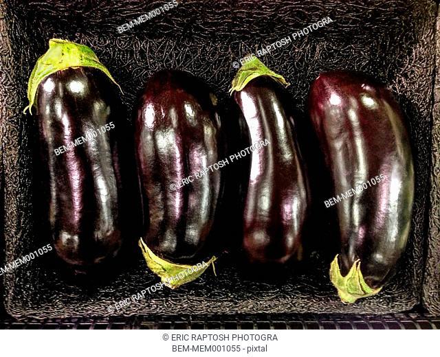 Close up of basket of eggplants