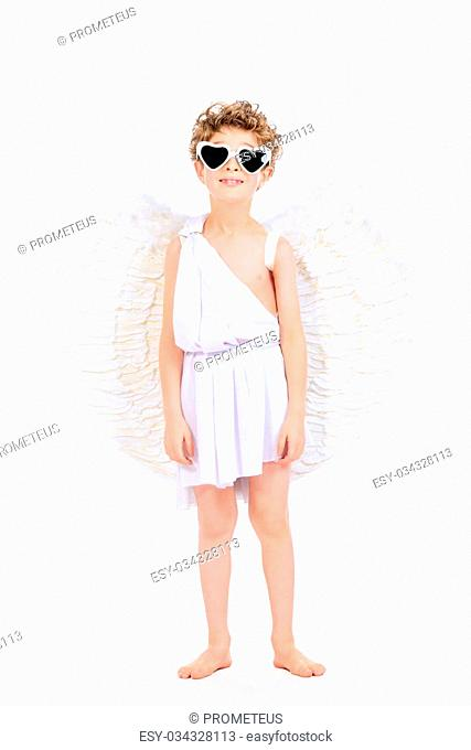 Cute emotional little boy in a costume of angel. Cupid. Valentine's day. Isolated over white