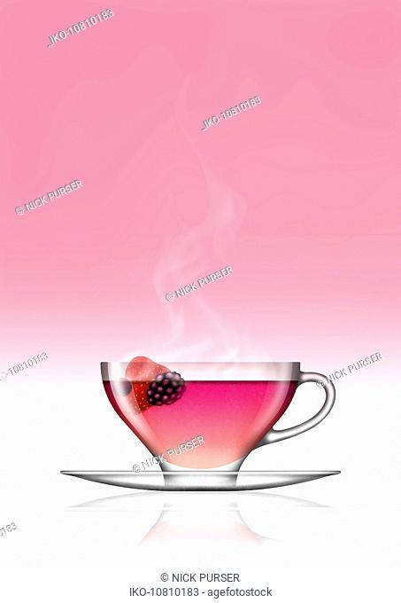 Fruit tea in glass teacup and saucer