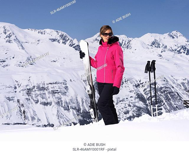 Skier standing on snowy mountain