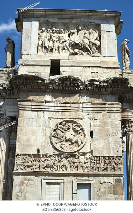 A battle scene and a frieze of soldiers on the three arched gate of the Colosseum, Rome