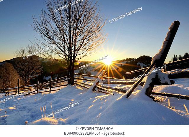 sun rising over Dzembronya landscape in Ukraine Carpathian Mountains