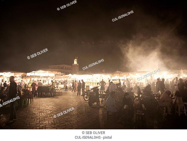 Crowds at food market stalls at night, Jamaa el Fna Square, Marrakech, Morocco