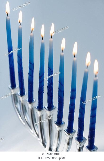 Close up of menorah with lit candles