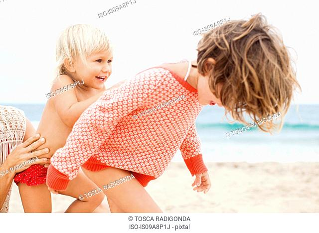 Sisters playing on beach