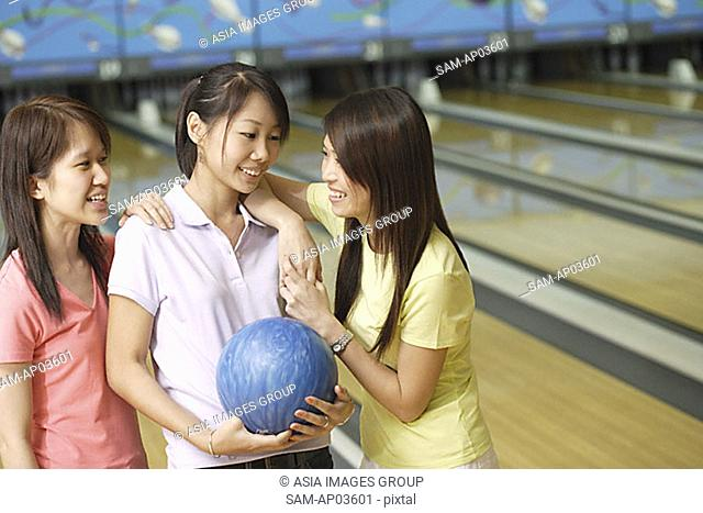 Women at bowling alley, talking