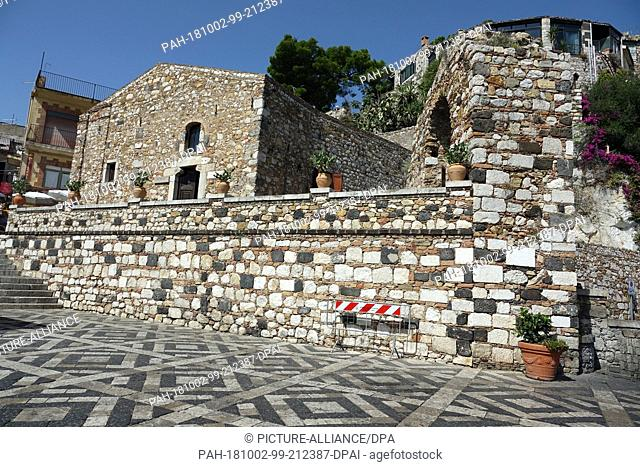 06 September 2018, Italy, Castelmola: 06 September 2018, Italy, Castelmola: Stones of different colours are used in patterns in Piazza Sant' Antonio in the...