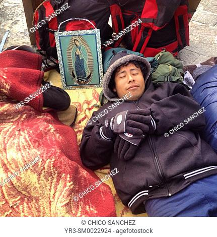 A pilgrim sleeps during the annual pilgrimage to the Basilica of Our Lady of Guadalupe in Mexico City, Mexico