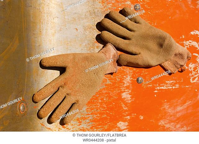 Work Gloves on Metal Surface