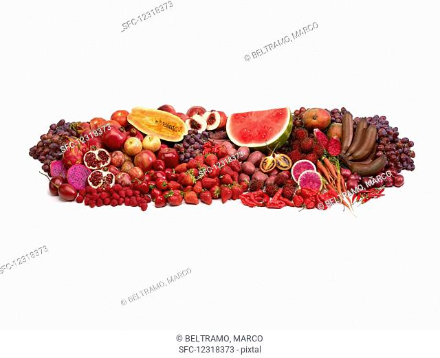Red fruit and vegetables in front of a white background
