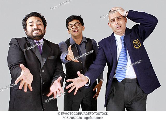 Three business men expressing sorrow over a disaster
