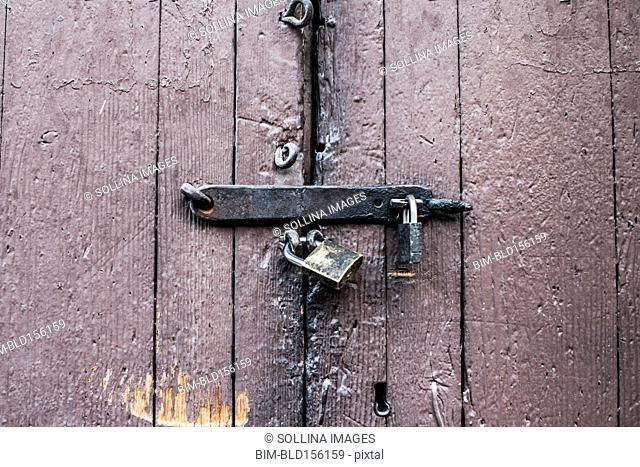 Close up of padlocks on secure door