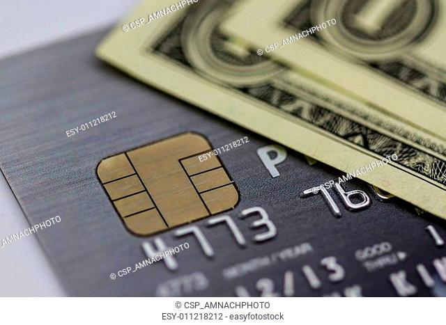 Secure chip of credit card cover with dollar banknotes