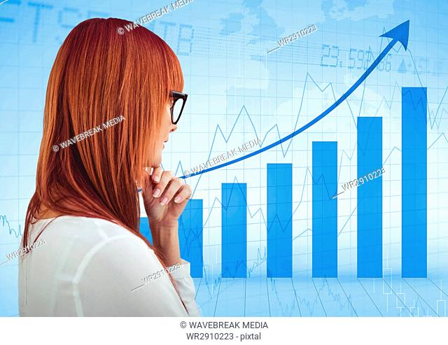 Back of woman thinking against blue graph