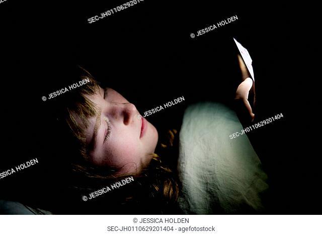 Teenage girl (13-15) sleeping in tent