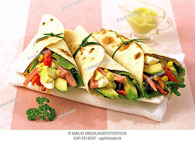 Mexican fajitas with salad and ham